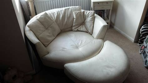 cream leather cuddle swivel chair   moon foot stool  worthing west sussex gumtree