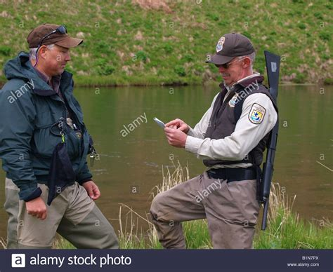 us federal fish and wildlife officer checks fisherman s