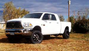 white dodge ram with rbp 96r wheels and black grill