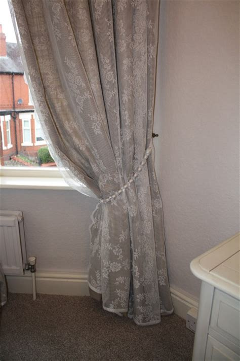 How To Hang Curtain Tie Backs Lace Overlay Curtain With Beaded Tie Back Traditional