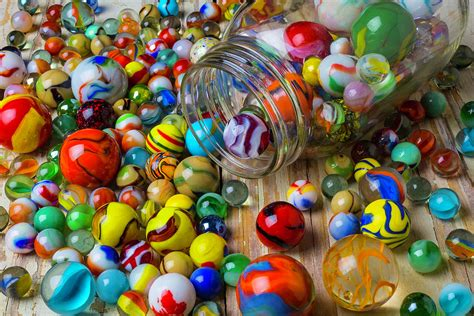colorful marbles jar spilling colorful marbles photograph by garry