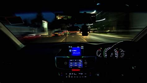 bmw dashboard at night driving timelapse from car interior driving on highway at