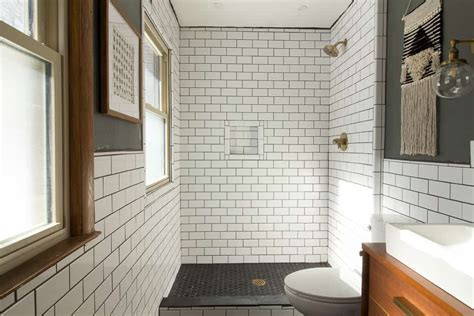 our modern subway tile bathroom bright green door