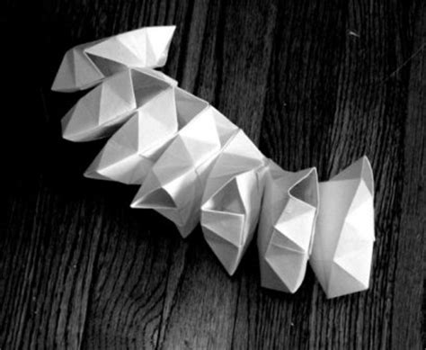 Helix Origami - folding the circle as both whole and part
