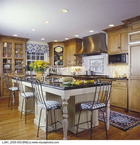 kitchen stained cabinets with white island   KITCHENS