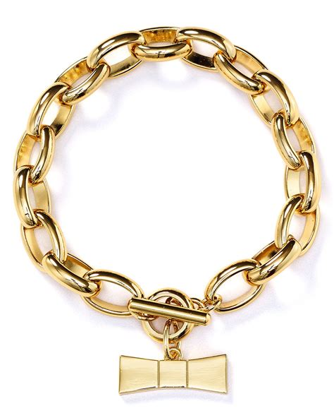 kate spade hummingbird bow charm bracelet in gold lyst
