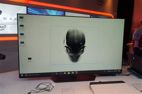alienware 55 inch 4k oled monitor look level up your living room gearopen