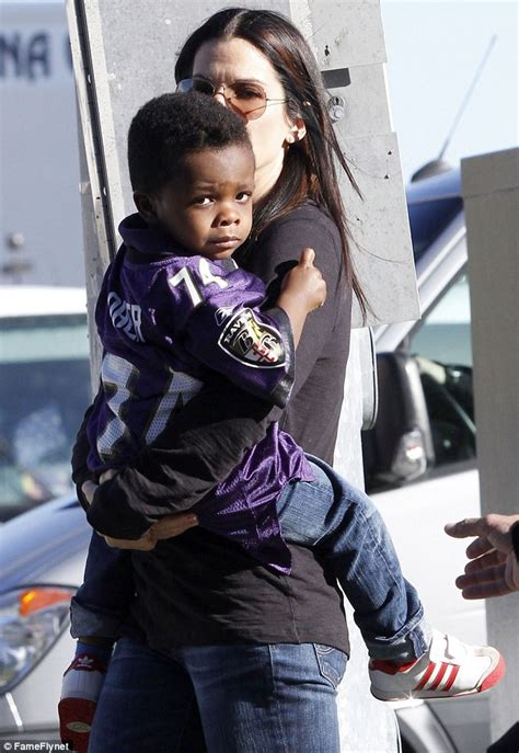 Blind Side Football Player Baltimore Ravens Sandra Bullock At The Super Bowl With Son Louis Sporting