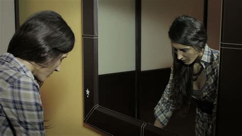 bathroom video clip depressed woman looking in the mirror at his ironic