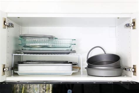 kitchen shelf risers 12 stellar ways to organize your kitchen cabinets drawers
