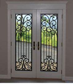 bristol wrought iron glass door insert installed in