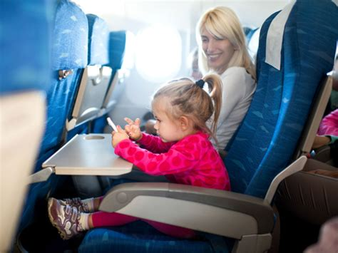 10 Tips For Flying With Baby Or Flights Ha This Sassy Two Year Is All Of Us On An Airplane