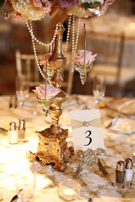 wedding centerpieces on wedding table numbers glitter ta