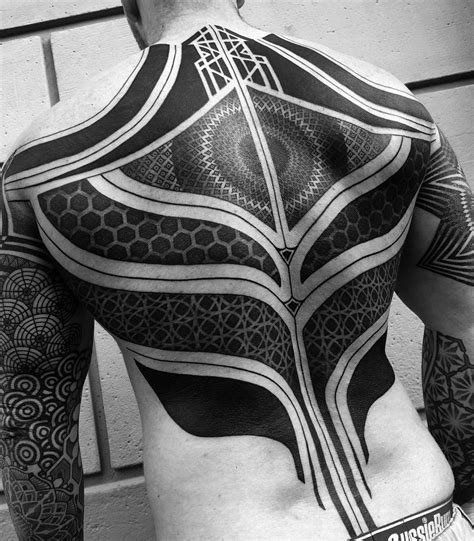 10 artists who create striking geometric tattoos spanning