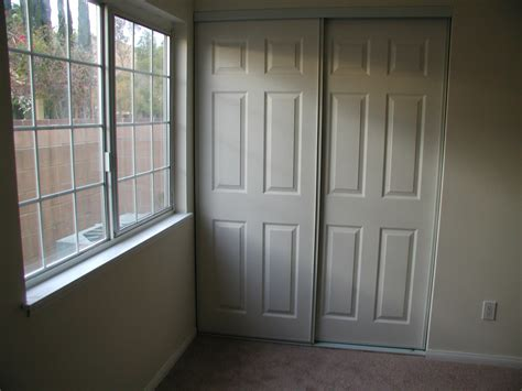 bedroom raised panel sliding closet doors picture after