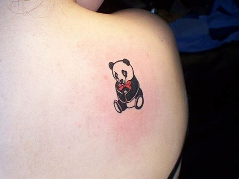 tattoo panda girl black tiny panda cub tattoo on back shoulder by megan