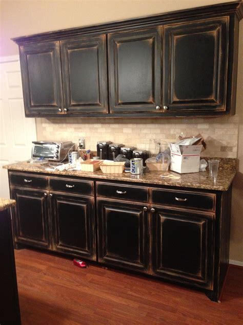 how to faux paint kitchen cabinets black cabinets with faux distressing used 3 different