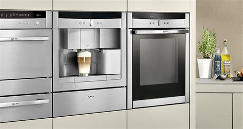 cherry wood kitchen with neff and bosch appliances posot neff appliances at london kitchen store