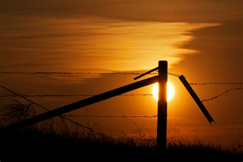 canadian buying a house in cuba fenced in alberta prairie sunset iocchelli fine art photography