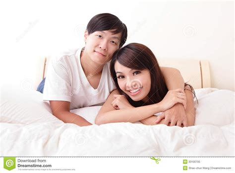 people in bed young lovely couple lying in a bed royalty free stock