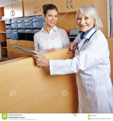 Hospital Receptionist by Doctor At Hospital Reception Royalty Free Stock Image Image 32668046