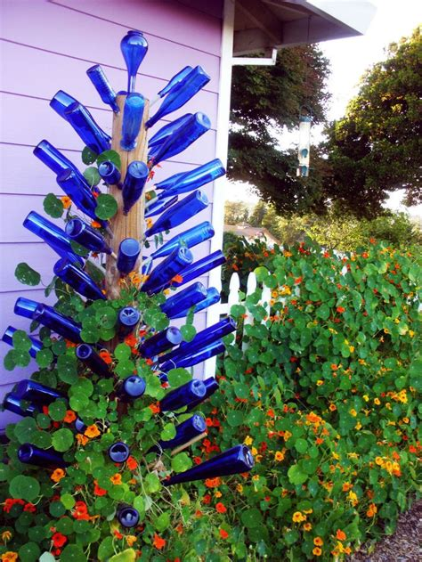 bottle trees and the whimsical of garden glass 1000 ideas about bottle trees on garden