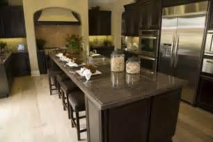 Dark wood cabinet kitchen with dark granite light flooring and tile