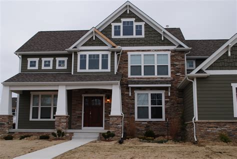 dark gray siding house vinyl siding and stone combination we like the dark gray on this post home