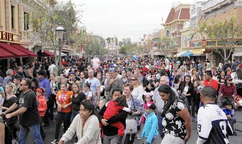 theme park queue management disneyland prepares for crush of visitors during 60th