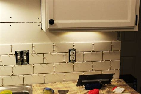 how to put up backsplash in kitchen how to install a subway tile kitchen backsplash