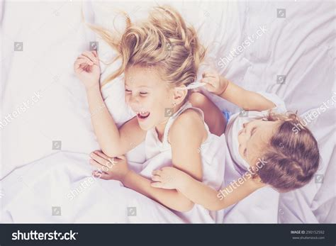 brother and sister in bed lovely brother sister lying bed home stock photo 290152592