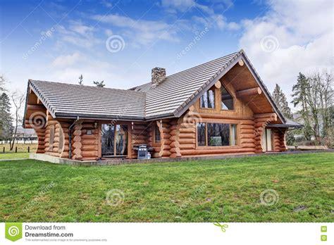 large log cabin large log cabin house exterior with grass filled back yard