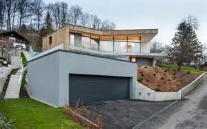 3 storey home on steep slope with grass roofed garage modern house designs