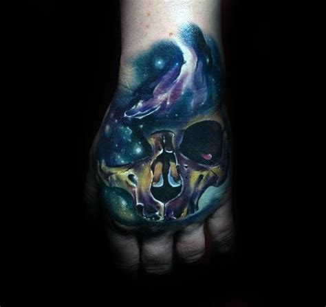 tattoo on outer hand 80 skull hand tattoo designs for men manly ink ideas