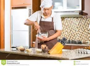 asian man baking cake in home kitchen royalty free stock photos image 29397928