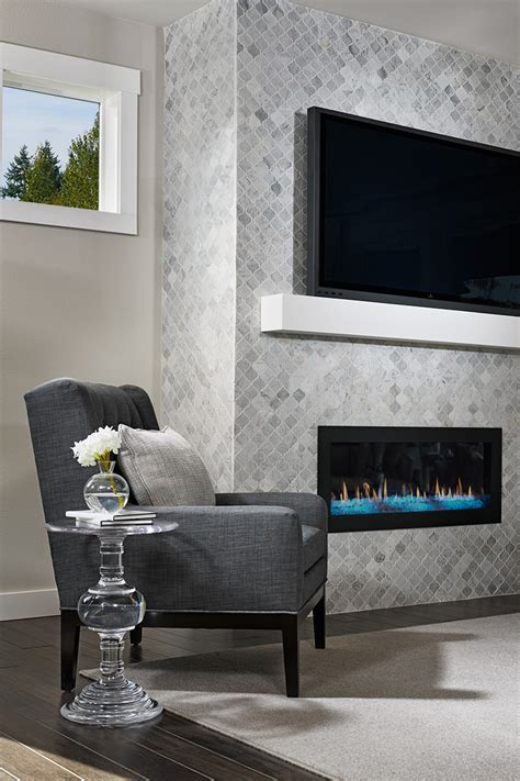 Floor to ceiling tile fireplace surround in our Lincoln