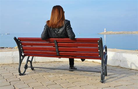 outdoor sitting bench a girl sitting on the bench public domain free photos for