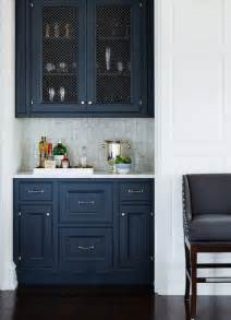 These classic navy cabinets are beautifully contrasted by a pearly