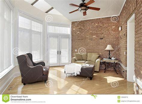 cer di lusso interni stanza di sun con il muro di mattoni fotografia stock