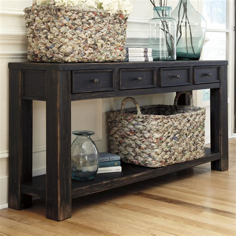 distressed sofa table with drawers signature design by gavelston t732 4 distressed