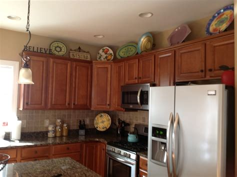 Decorations On Top Of Kitchen Cabinets Top Of Cabinet Decorating Ideas Decor Ideas Decorating Ideas Cabinets And Top
