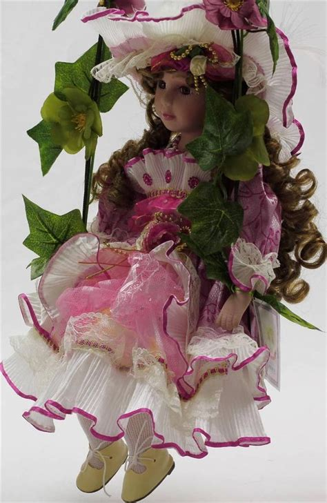 porcelain doll on swing collectib porcelain limited addition doll on