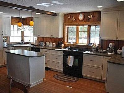 kitchen cabinets on knotty pine walls 1000 ideas about knotty pine paneling on pinterest