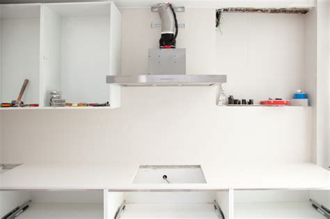 how does it takes to install kitchen cabinet
