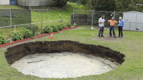 sinkhole in backyard abroad a massive sinkhole in backyard is growing by the hour