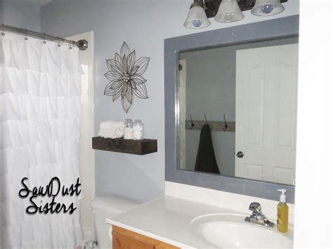 how to make a frame for a bathroom mirror diy bathroom mirror frame sawdust sisters