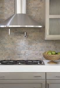 gray backsplash kitchen kitchens pot filler tumbled linear tiles