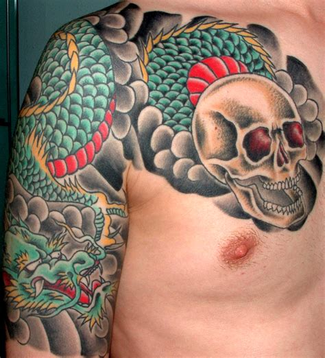 arm and chest tattoo skull design on arm chest tattooshunt