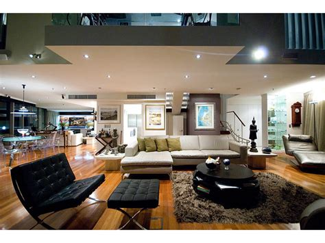 Open Plan Living Room Using Black Colours With Floorboards