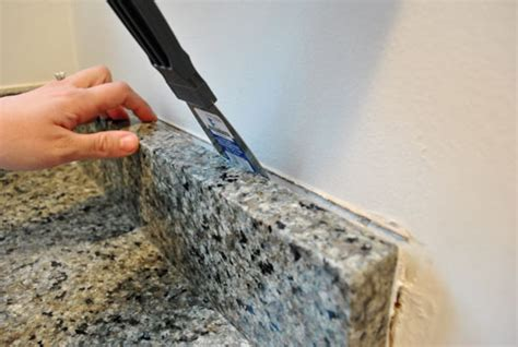 Removing Granite Countertop removing the side splash backsplash from our bathroom sink house